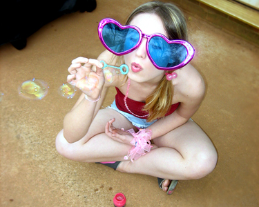Cute little doll blowing bubbles … and maybe more
